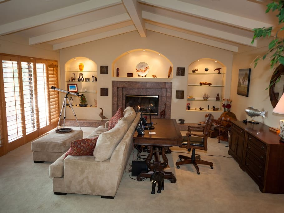 Warm and welcoming living room. A place to read, write & enjoy magnificent views