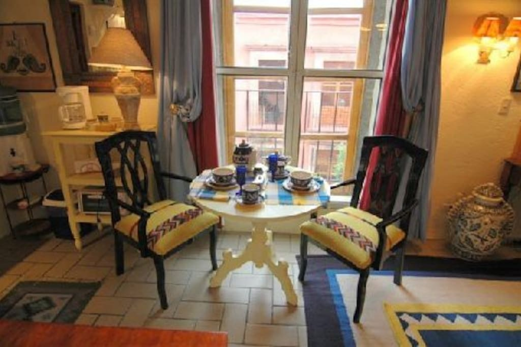 Breakfast area, with French-style doors opening to a tiny terrace facing Mesones. Photo by Robert de Gast