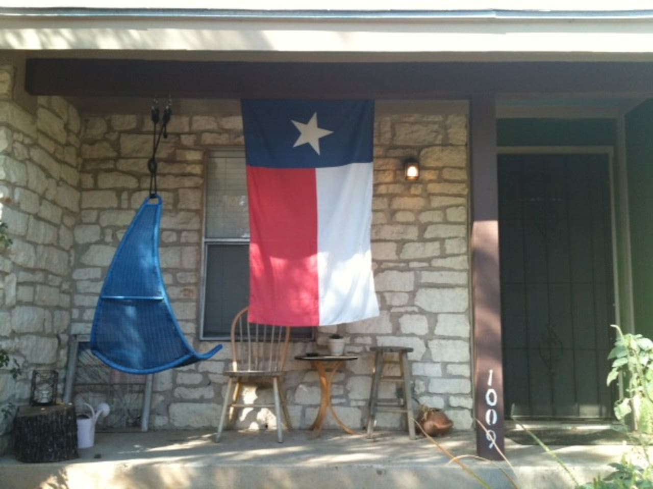 Detail of front porch: swing and texas pride! :)