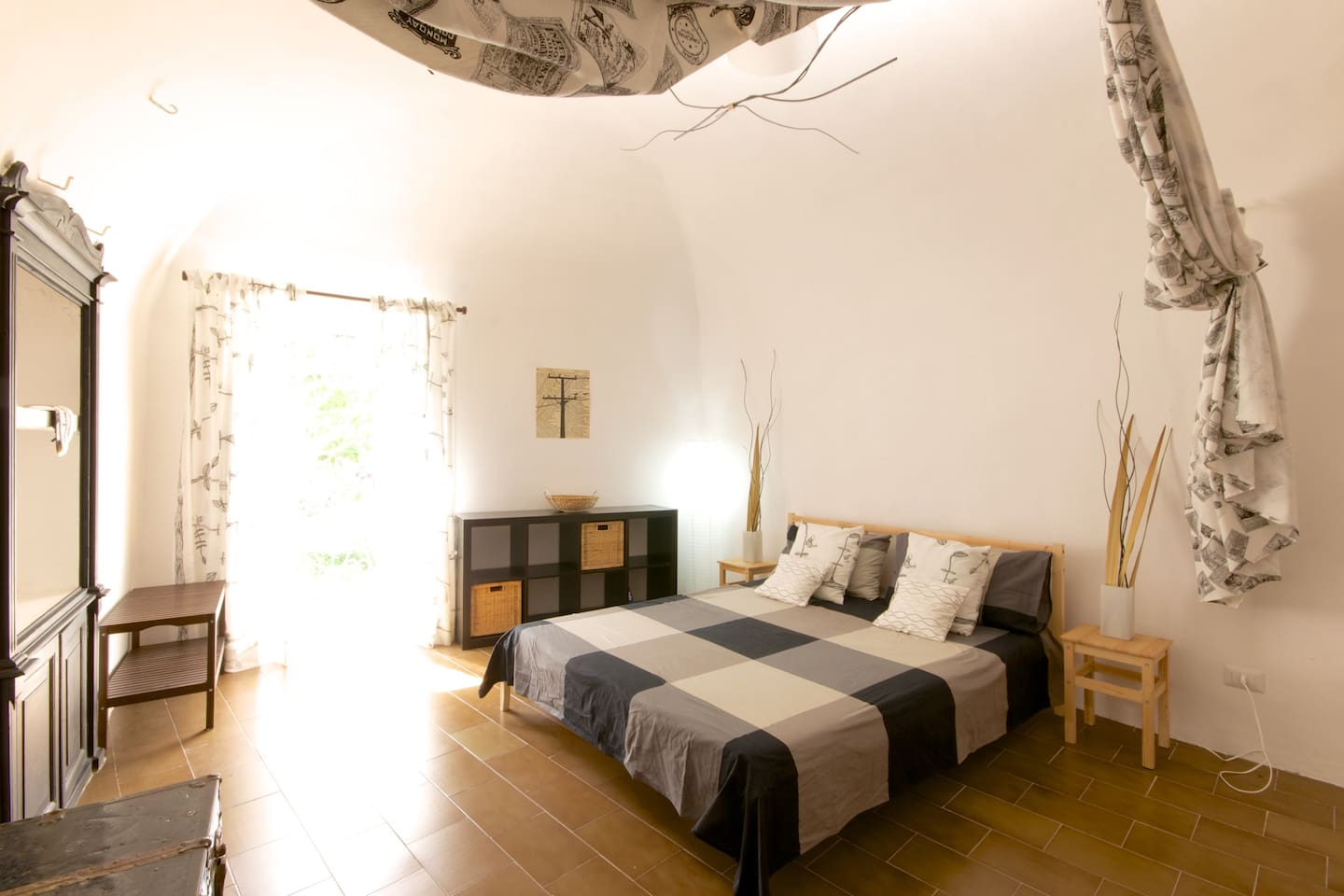Stunning large master bedroom with a lovely private balcony view of the town.