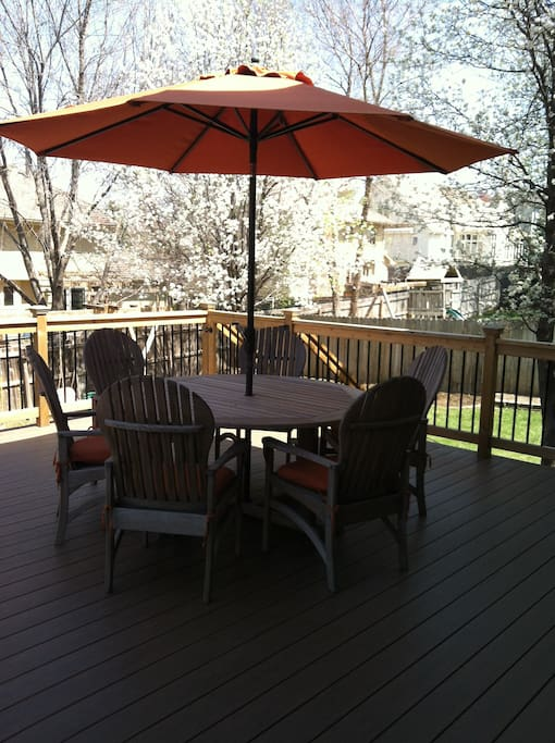 Huge deck overlooking backyard.  Access to swing set and gas grill.