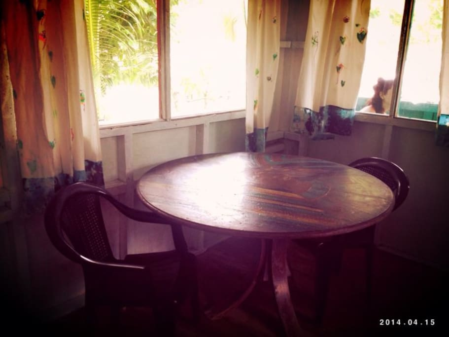 Inner Table with seats, for you to enjoy a breakfast or simply seat and play cards with a friend
