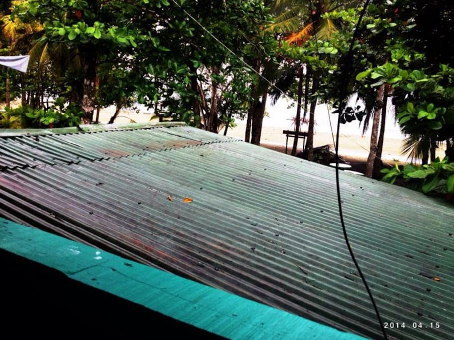 View from the balcony porch, you can enjoy a coffee or a smoke with a tree beach view