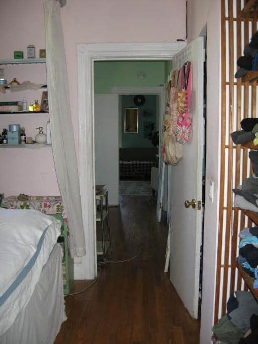 Looking from my bedroom down the hall to the guest room at the end. 2 doors and 1 room separate us, so it's quite private.