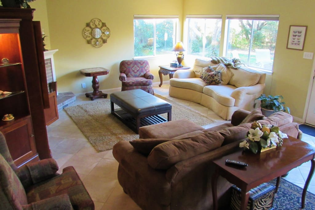 This Living Area Includes an LED TV, Cable with 200 Plus Channels and Sound System.  It is Adjacent to the Kitchen and  Leads to the Backyard Deck