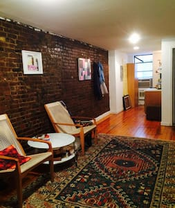 The apartment stretches from the front to the back of the building and has a lot of character centrally located in the heart of downtown where the Lower Eastside, Soho and the East Village meet-- a joyful spot to wind down, wake up, work or cook.
