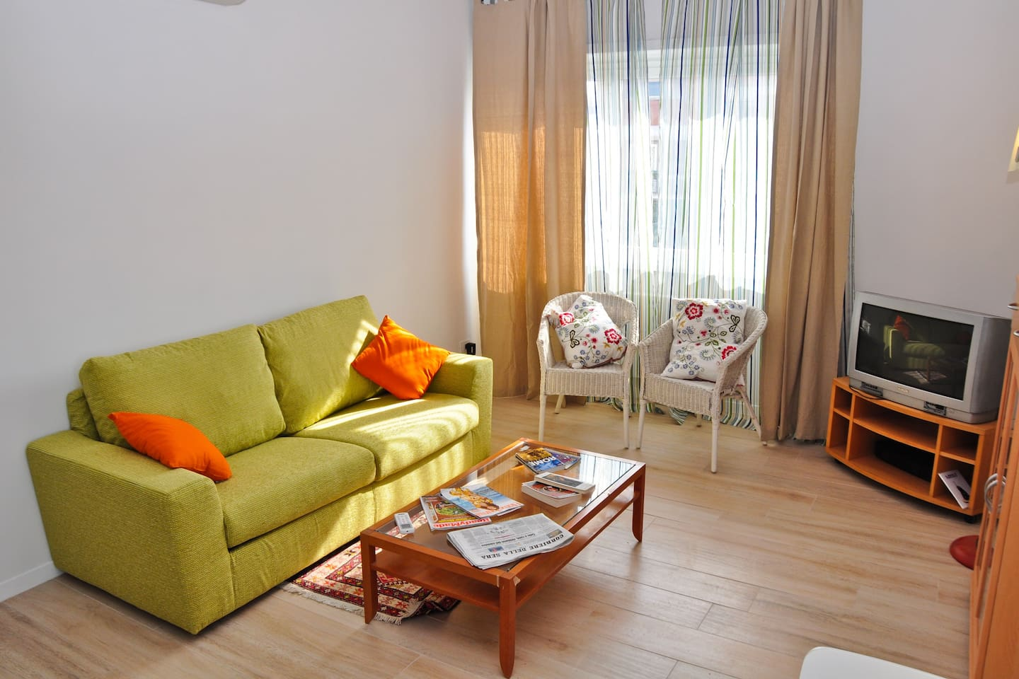 LIVING ROOM:THE GREEN SOFA BED CAN COMFORTABLY HOST TWO PEOPLE.MAPS , BOOKS , DVD ARE PROVIDED.