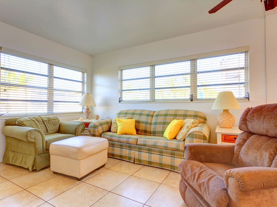 Stretch out and relax in our Florida style living room. Everything about our living rooms makes you want to stretch out and relax! Sit back and listen to the Gulf breeze rustle the palms as you catch up on your favorite TV show.