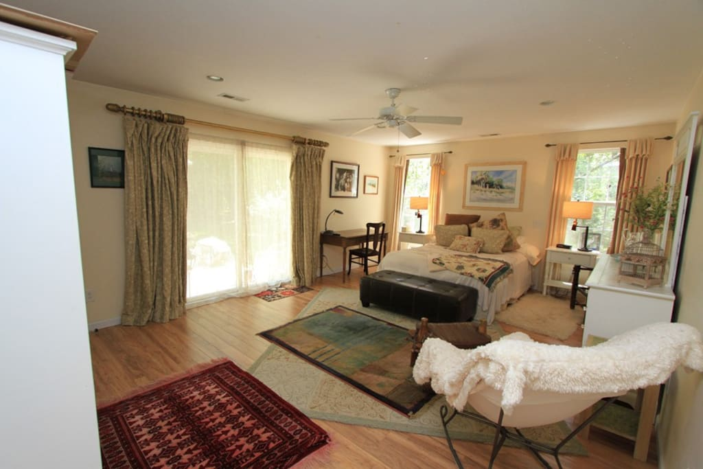 comfortable queen size bed with luxury bedding. Sliding glass door opening to the private back yard.