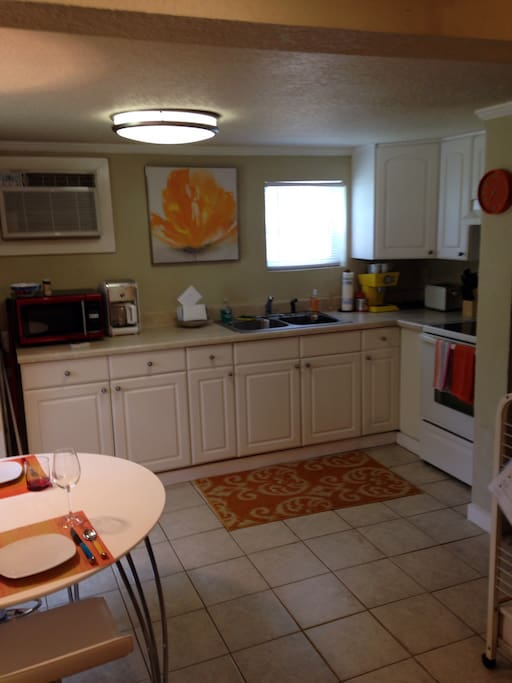 Spacious kitchen with seating for 4 and full sized appliances.Ample sized accoutrements.