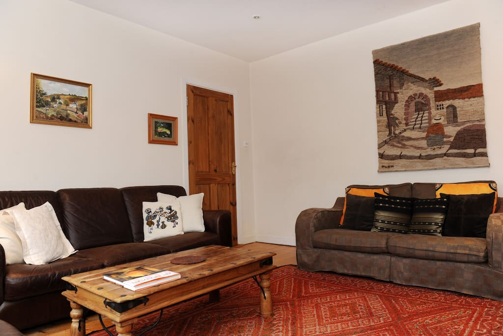 lounge, with open fire and large flat screen Sky TV and dvd player