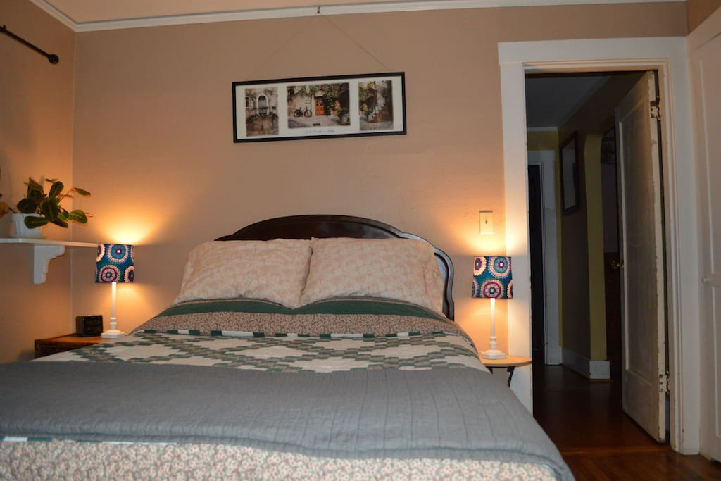 3 - A queen size bed in the bedroom.
