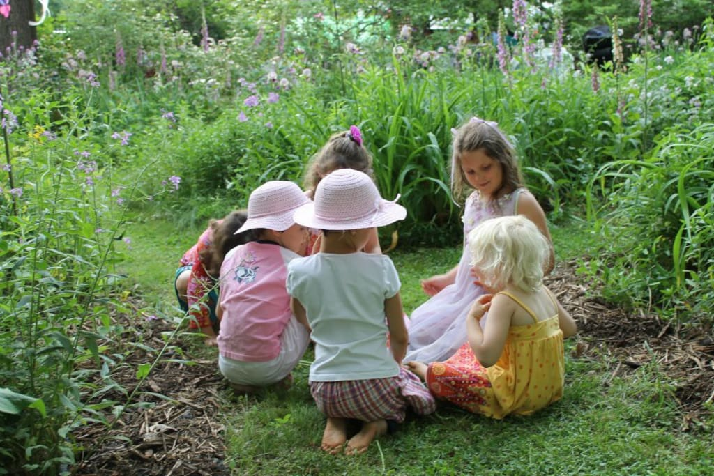 Little girls in the garden during a party
