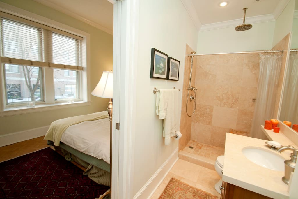 This shows the marble bathroom and shower with two shower heads.
