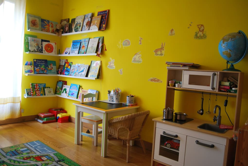 Children's room has a book corner, crafts area, play kitchen, LEGO, educative toys for baby/toddler/preschooler