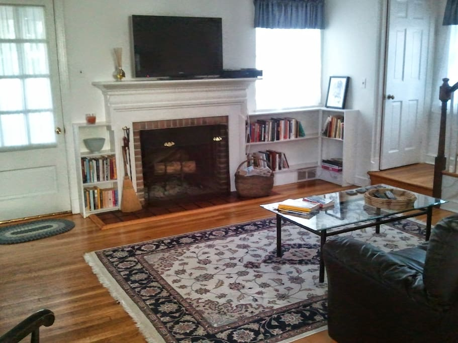 Living room, woodburning fireplace, door to screen porch