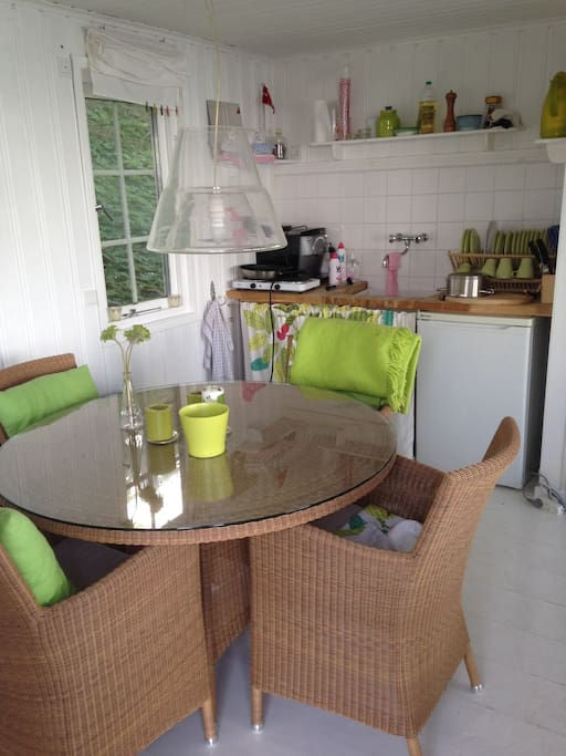 Dinner table and kitchenette inside the beach house