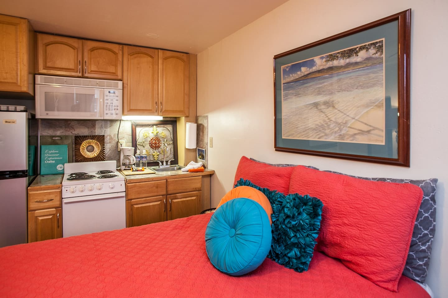 Queen size bed and kitchen