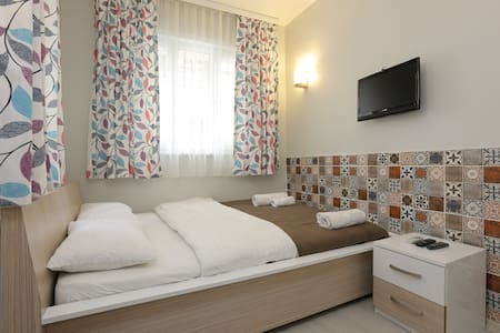 Newly remodeled and re-decorated, modern, bright rooms/flats in the middle of Istanbul, just off the famous and popular Taksim Square. Located just behind the historical museum hotel Pera Palace.