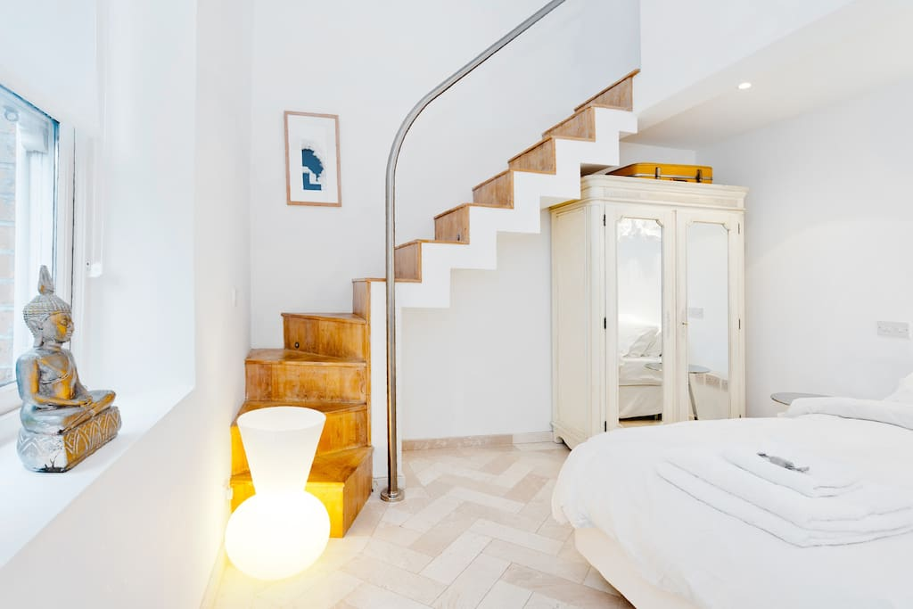 Main bedroom. Double height ceilings, everything you'd get in a 5* hotel, lighting control from the bed, underfloor heating, space and light, quality mattress and bedlinen, private ensuite bathroom upstairs on mezzanine above.