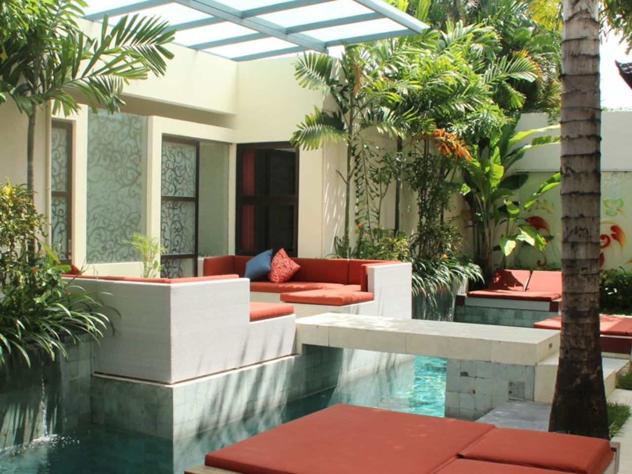 Terrace overlooking swimming pool in charming courtyard.
