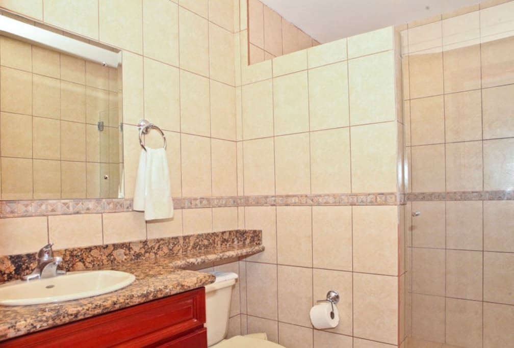 Nice size second bathroom with large shower.