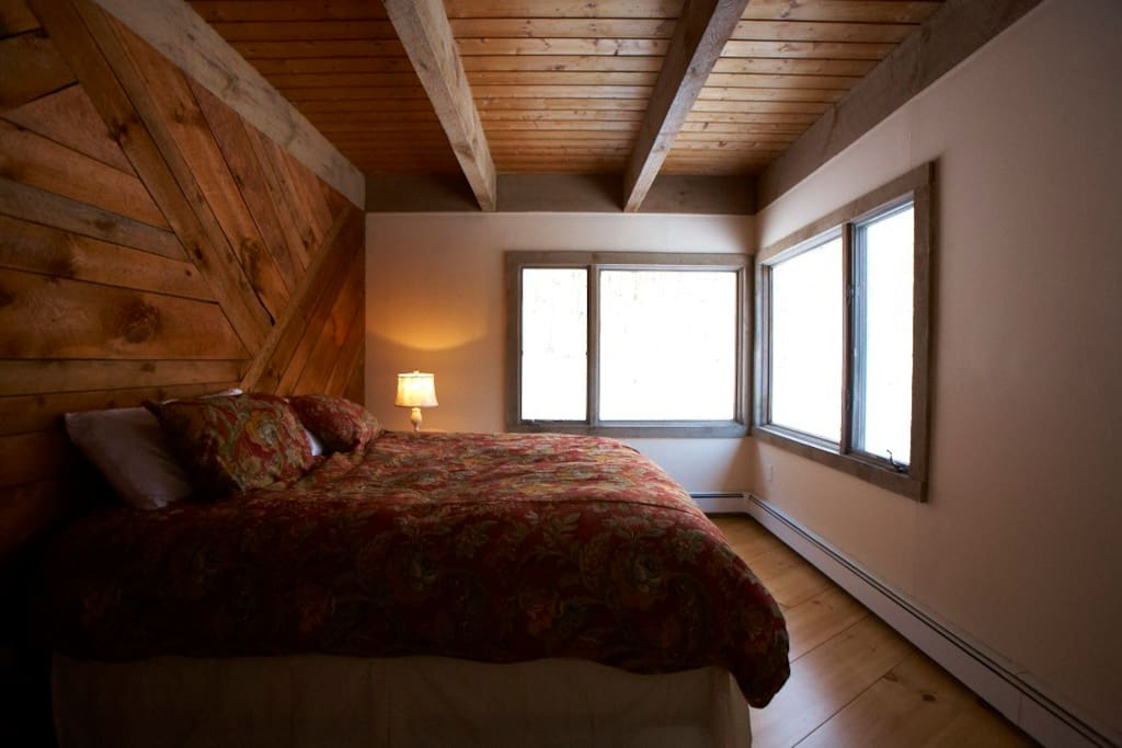 Guest bedroom with king size bed and beautiful sunrise view