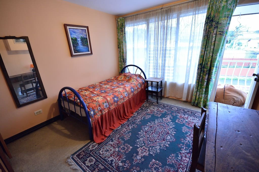 Single bed in one of the rooms with balcony