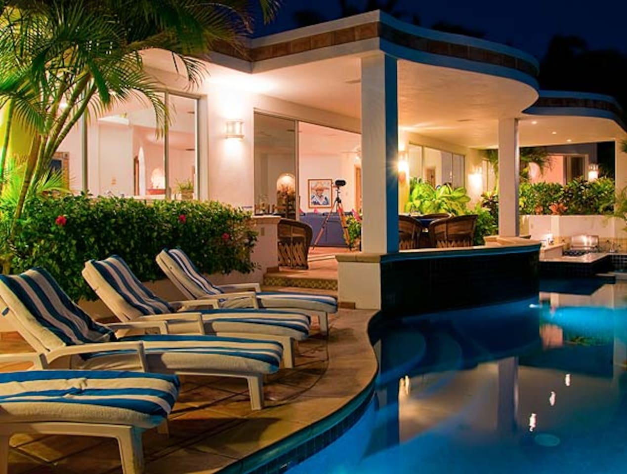 Outside terrace and covered patio overlooking the infinity pool.