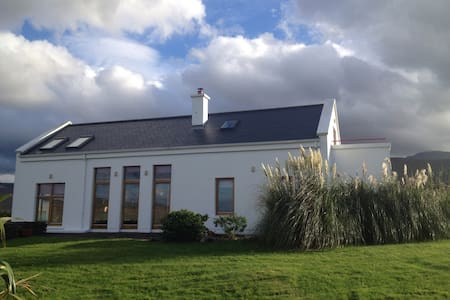 Situated in one of the most beautiful places in Ireland . Just 9K outside the vibrant town of Dingle our home sits at  foot of Mt Brandon with panoramic views over the Atlantic Ocean. Enjoy golfing , walking hiking cycling and the sheer beauty of the place ! Heavenly !
