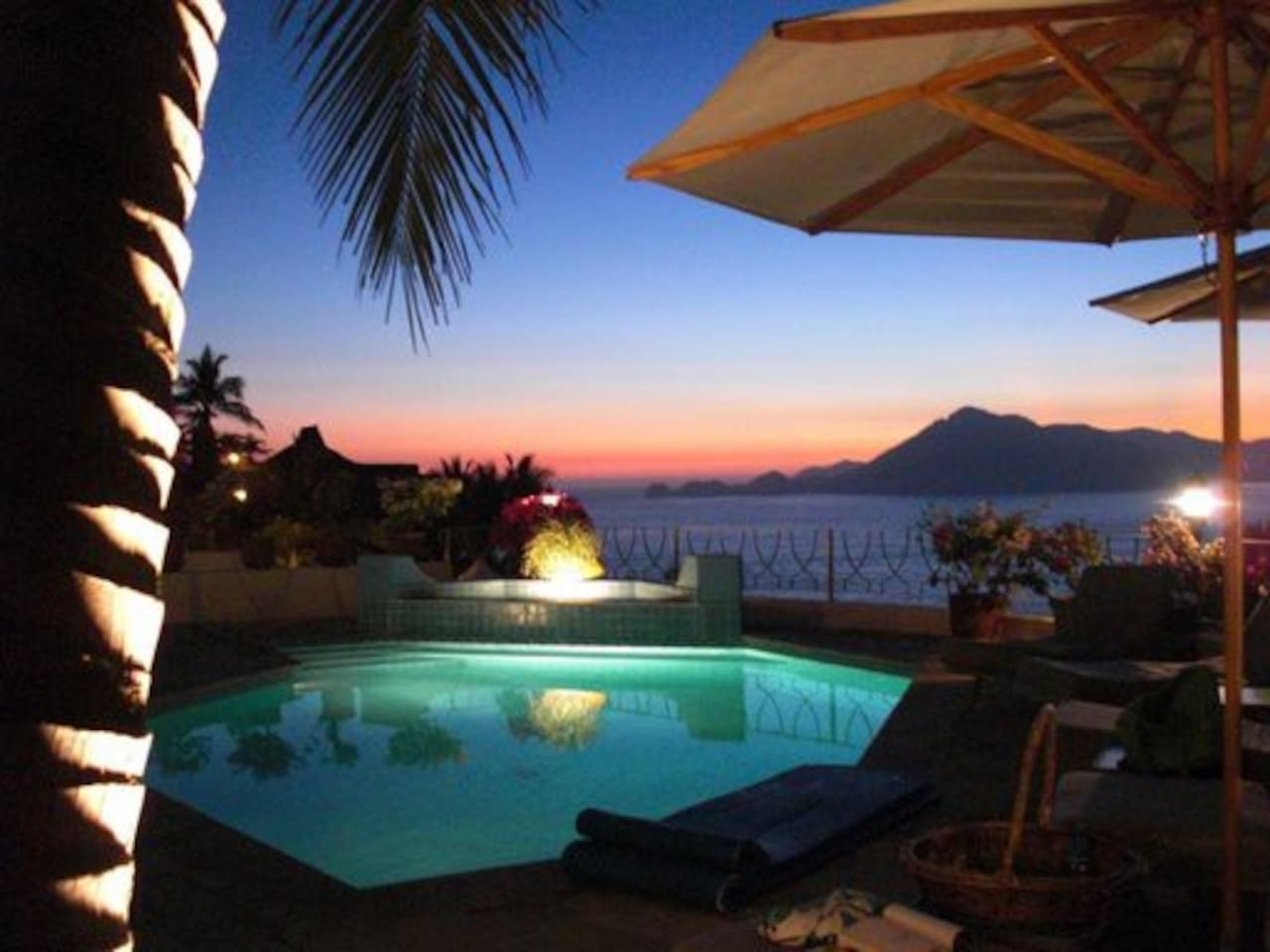 Lower pool overlooking Bay and Pacific Ocean view from palapa