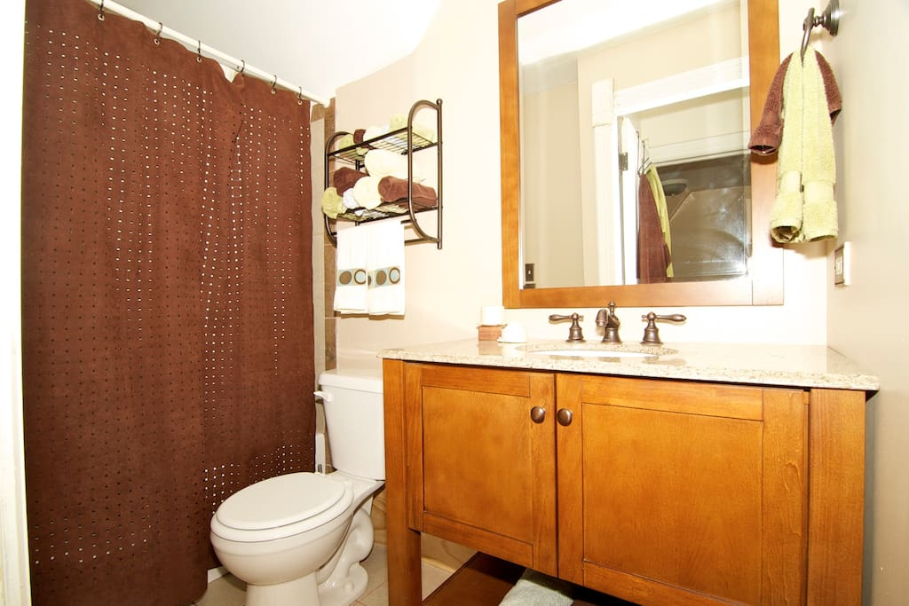 Shared hall bathroom with shower.