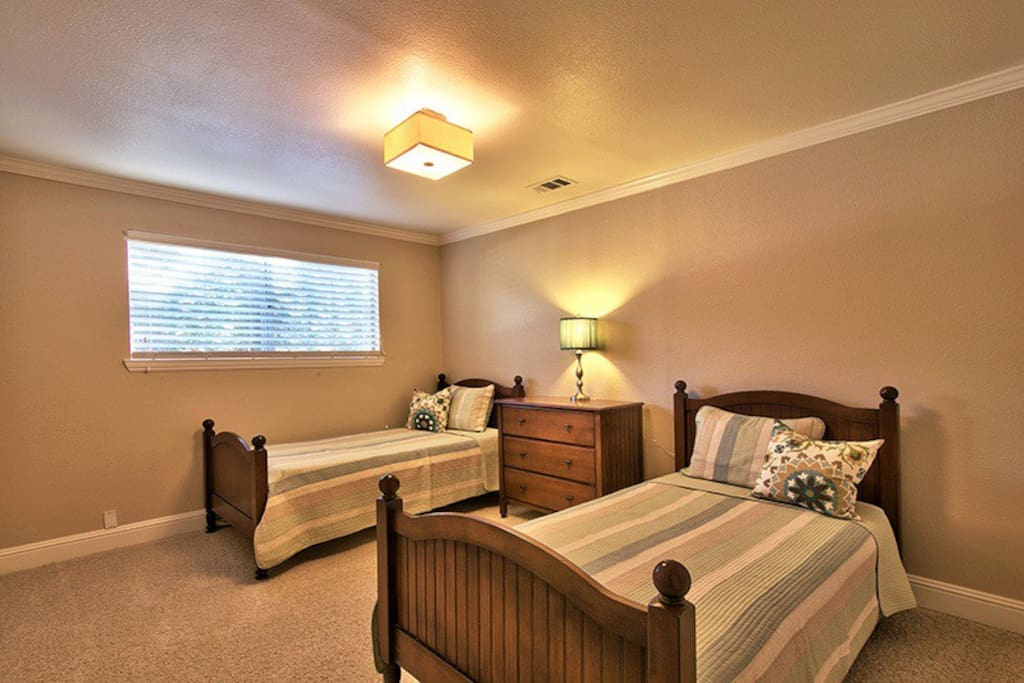 Twin beds in one downstairs bedroom.