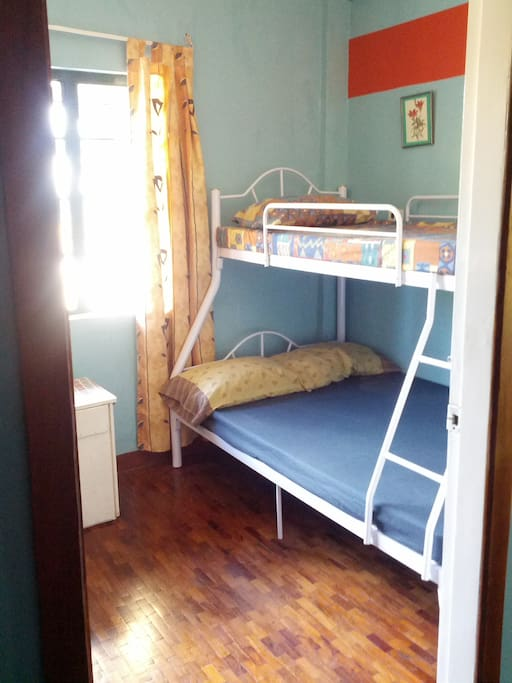 Room 1 beds have a double-size lower bunk and a single-size upper bunk