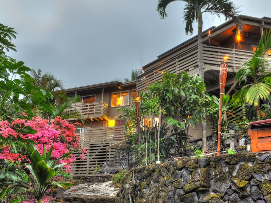 View from the garden of back of house. Upper unit on Left is the Lookout and below the Lanai. Owners unit is the upper right.