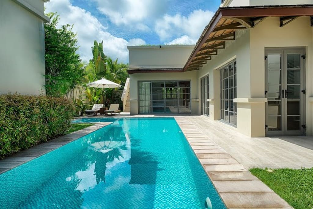 Extended to 35 sq.m. swimming pool with sunbeds and umbrellas on the terrace