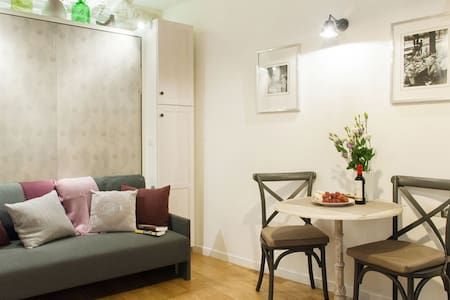 Adorable studio for up to 2 Guests. Located in the exclusive Marais St Paul area, steps from Notre-Dame, Hotel De Ville and Ile Saint Louis.  Located on one of the most charming squares in Paris- Place Sainte Catherine.