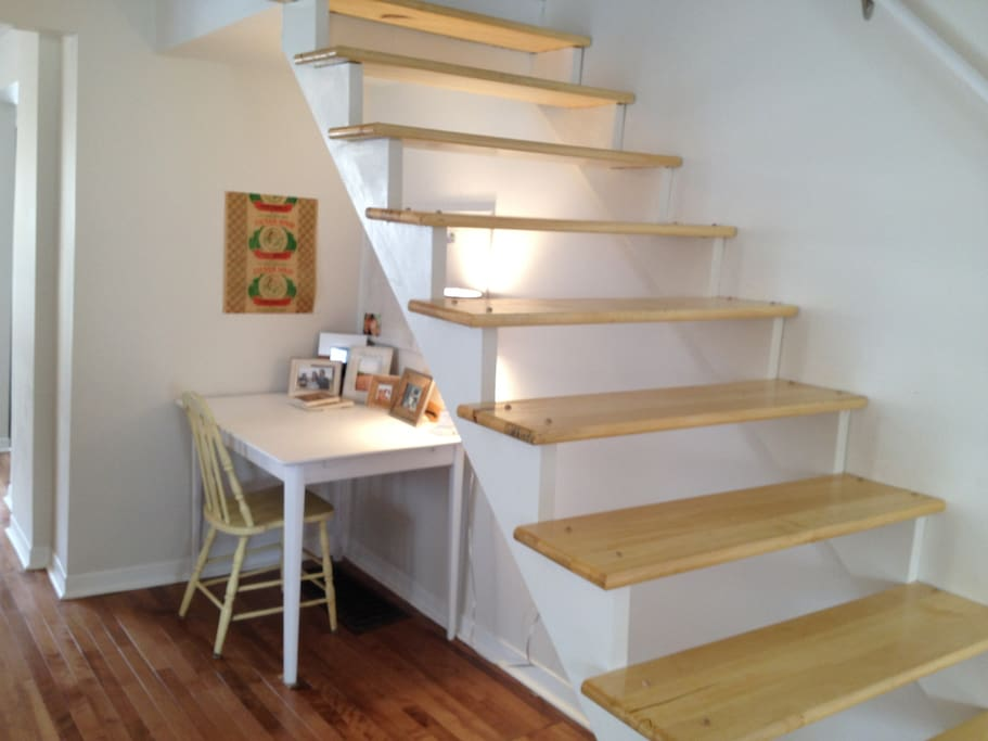 Open Stair Case with desk set up underneath. Wifi in the house