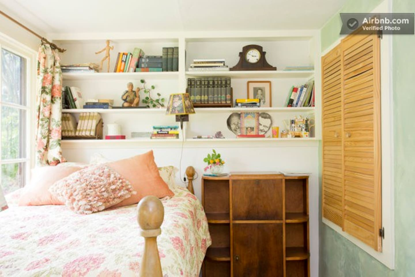 """The Rosie Room has heirloom roses outside the window.  The bed is elevated and is 6"""" wider than a full double."""