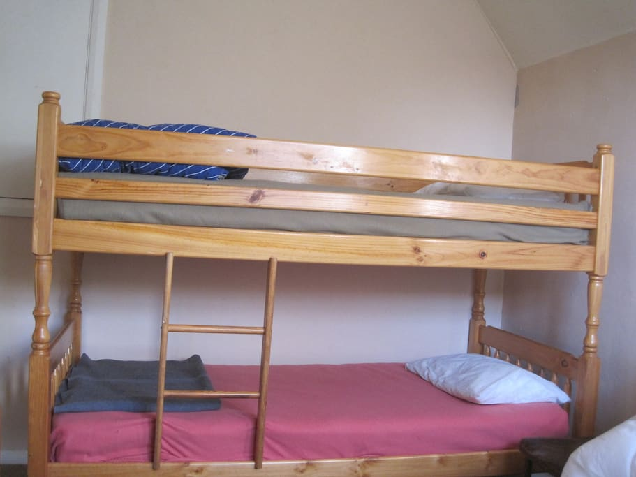 Some beds are bunk beds, all beds are single with mattress, pillow and blanket.  Bring own sheets/sleeping bag and towels!