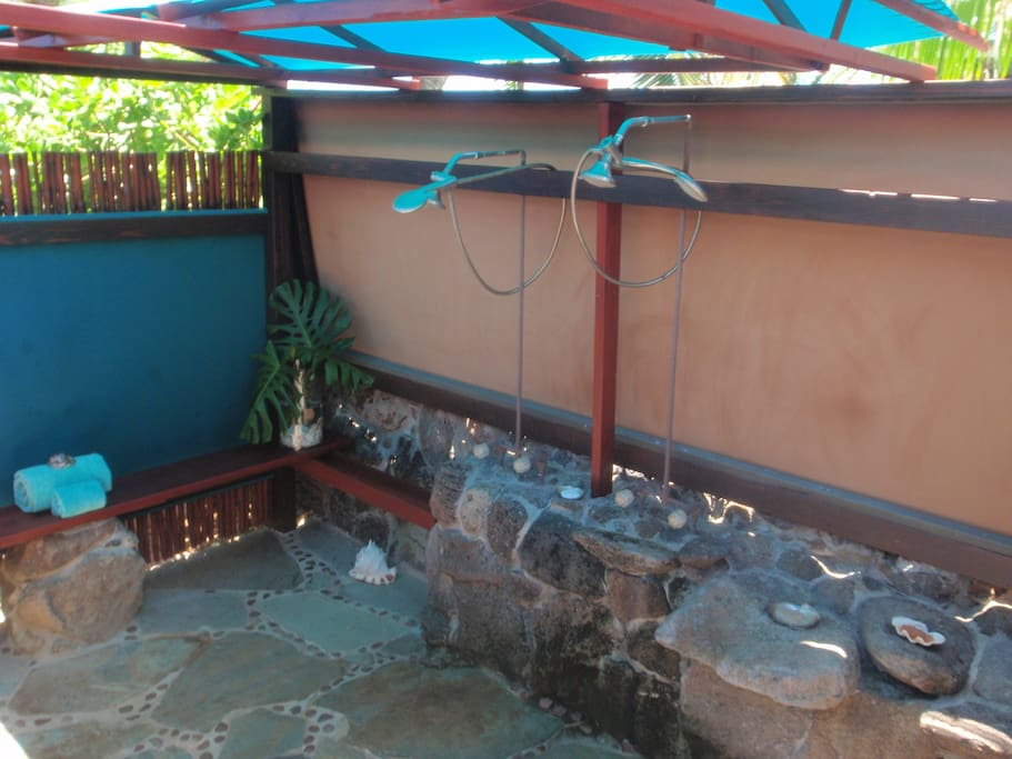 covered outdoor hot/cold shower