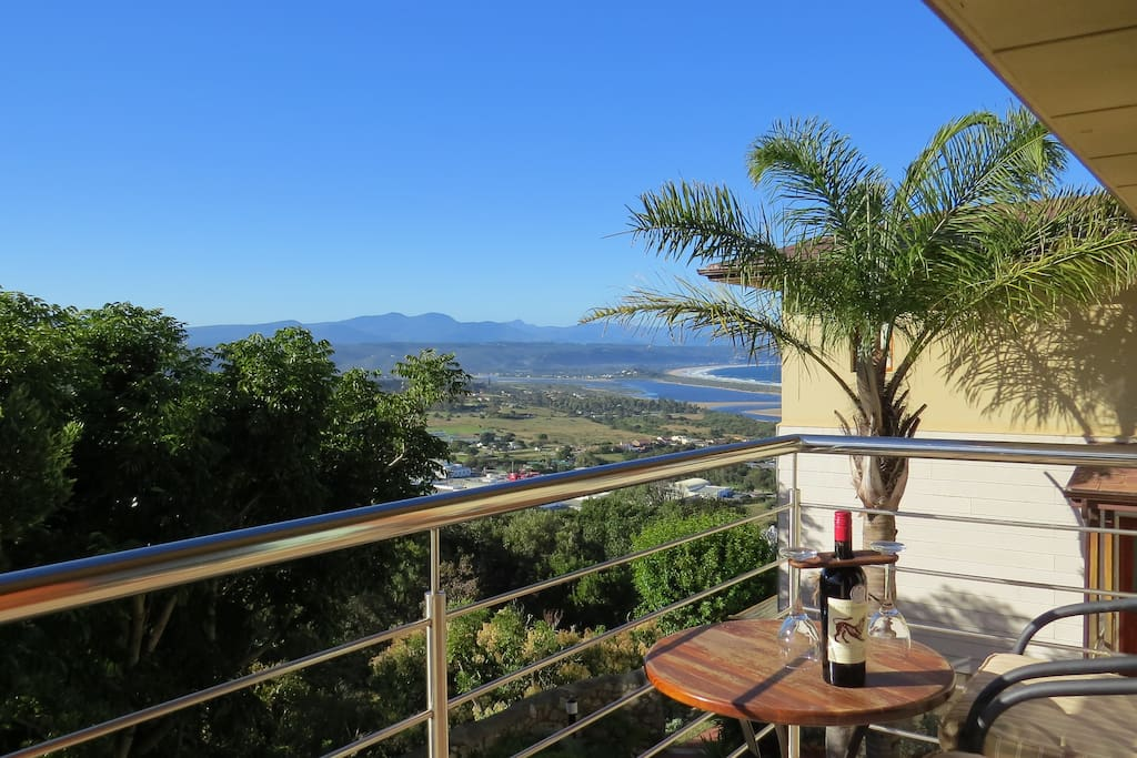 private balcony with views of the Tsitsikamma Mountains including Peak Formosa and treetop views of our garden.