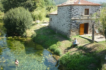 If you like nature then this is the right place. An old stone house refurbished with modern yet cosy style. Closed to Serra d'Arga (mountain) and Ancora River passing along the house making a beautiful natural pool with crystal clear water.