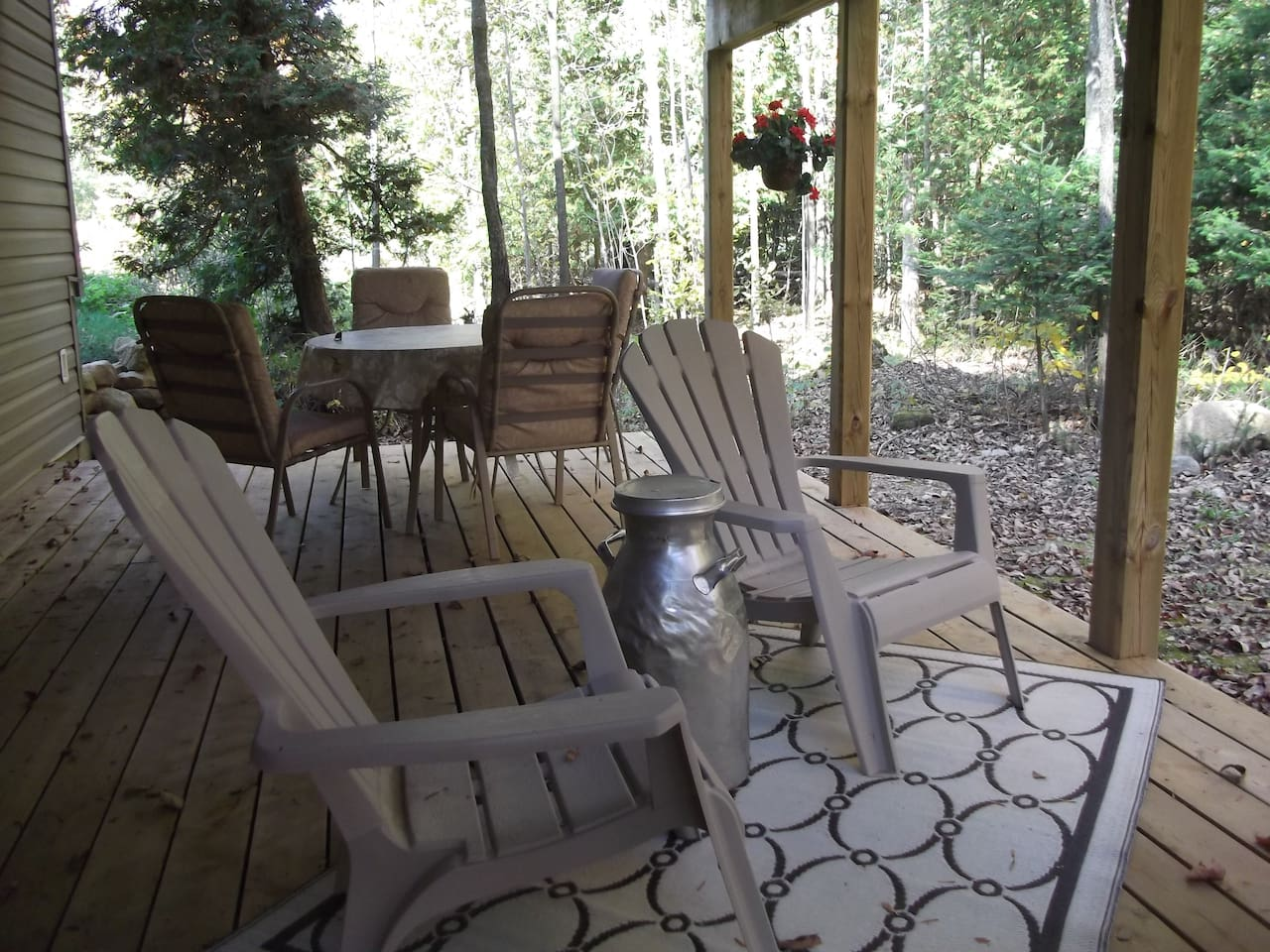 Private covered and furnished deck to enjoy the treed landscape.
