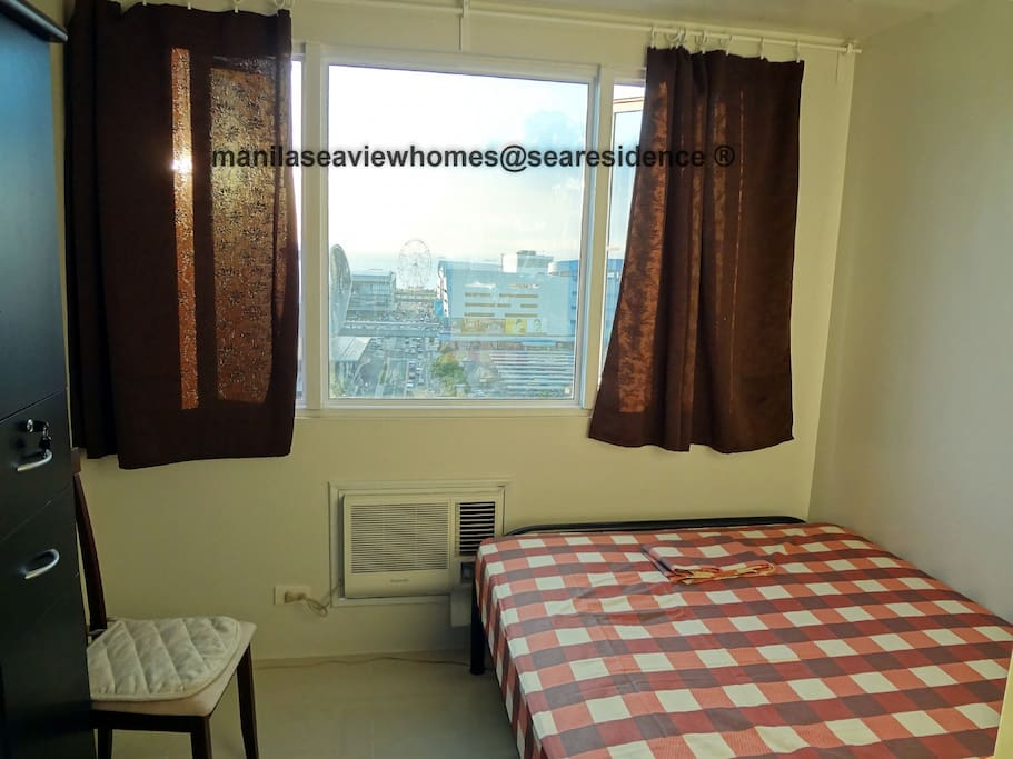 bedroom with view of Manila Bay