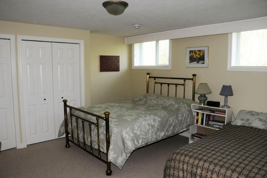 The larger guest bedroom for this listing, with 2 double beds