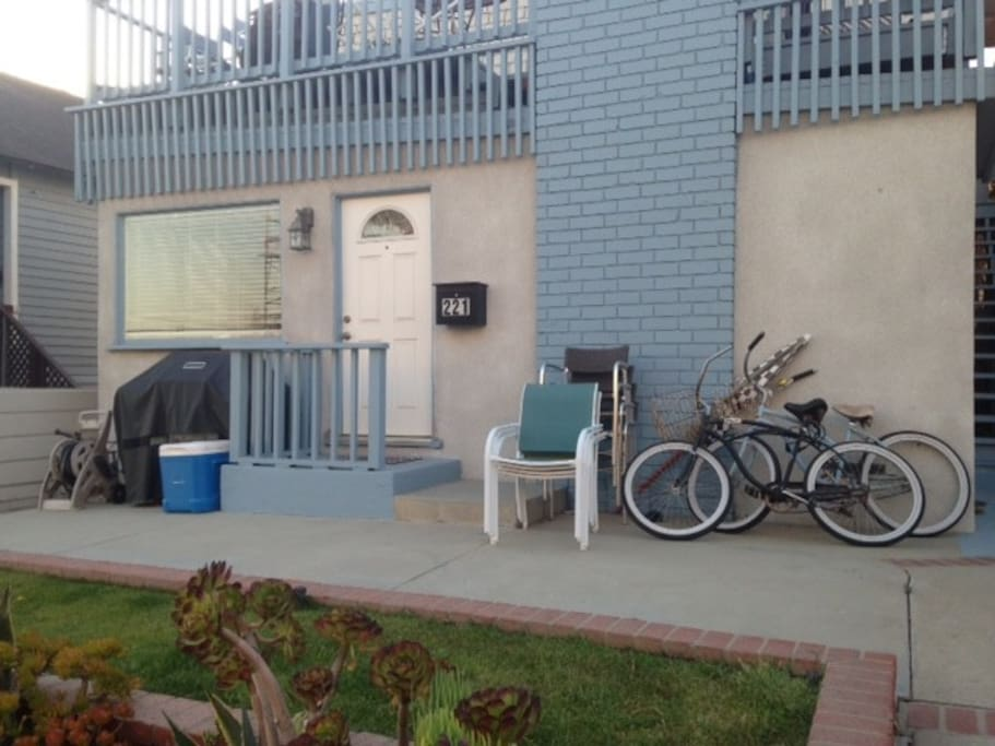 View of the patio and the front of the house; two beach cruisers available.