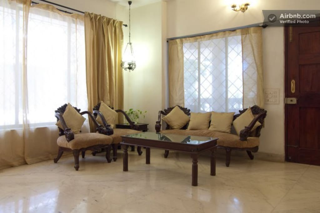 Common area - elegant living space with marble floors, antique furniture and premium fittings