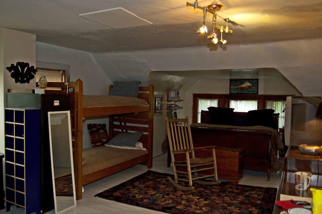 This is a view of the king sized bed and the bunk beds