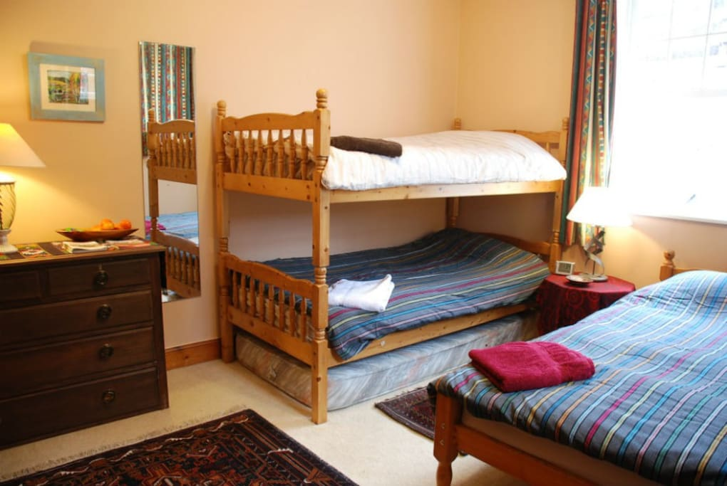 Newly redecorated bedroom 3 single beds, room for extra mattress on floor